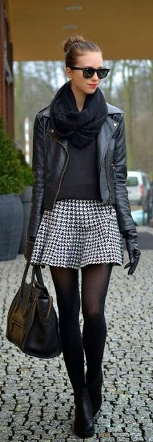Fall / Winter - street chic style - black tights + black booties + black sweater + black leather jacket + black scarf + black sunglasses + black handbag + black an white harris tweed pleated mini skirt