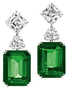Harry Winston emerald-and-diamond drop earrings.