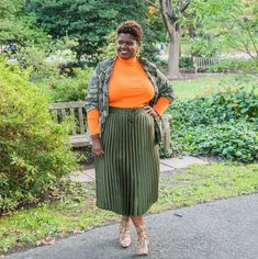 Long sleeve top, pleated skirt, booties and jacket | For more style inspiration visit 40plusstyle.com