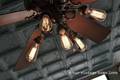 remove tulip shades from fan and use edison bulbs for vintage look