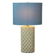 """Featuring a concentric diamond motif highlighted by a glaze finish, this eye-catching ceramic table lamp casts a serene glow over your living room or master suite decor.   Product: Table lampConstruction Material: Ceramic and fabricColor: Blue and creamFeatures: Diamond motifAccommodates: (1) 60 Watt bulb -  not includedDimensions: 24"""" H x 14"""" Diameter"""