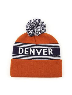 """A cuffed beanie featuring the text """"DENVER"""" and a small multi-colored pom pom on top."""