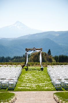 simple wooden wedding altar with white cloth decor in mountains