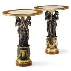 A pair of Empire style gilt and patinated bronze and burlwood guéridons | lot | Sotheby's