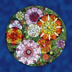 Fragments of Colour for the Flowers exhibition. Now on show at The View Tube, Stratford, London on the 2012 Olympic Site. Recycled stained glass. mosaic for