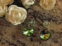 Sale:  Green iridescent handcrafted Swarovski bead dangle earrings by Glitteredtoo on Etsy