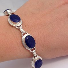 silver%925 natural blue% Sapphire bracelet  Amazing all natural %Sapphires 132 CTs-  8 inches long x .5 inches wide, bracelet, made of % 925 Sterling silver with 5 natural, hand shaped & smoothed, dark blue%Ssapphires, with Sterling silver link soldered together, and toggle closure. Handmade, NWOT, a beautiful rare, piece- great investment  Handmade Jewelry Bracelets