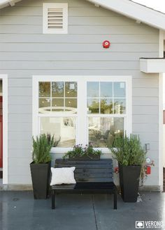 Kraft Project #exterior shot. Adorable black bench with planters to either side, next to the lovely main front window.  #veronohome #realestate #view #LosAngeles  http://www.verono.com/kraft/