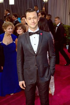 JGL wearing a Gucci black satin trimmed shantung silk notch lapel two button Dylan tuxedo with white dress shirt, black grosgrain bowtie, black satin cummberbund and black leather laceups