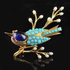 CARTIER.c1955.18ct yellow gold and multi-gem bird brooch.