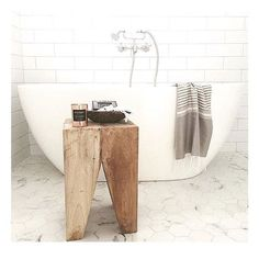 Three Birds Renovation. Bathroom with slant leg stool
