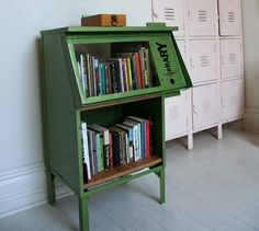 upcycled newspaper stand that functions as public nomad library in St Louis Obispo (via bookshelf porn)