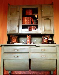 We restored this old cabinet with Chalk Paint™ by Annie Sloan in Chateau Grey with Dark Soft Wax by Interiors to Inspire