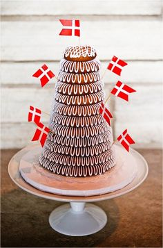 Denmark flags and thick icing decorate kransekake @myweddingdotcom