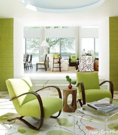 In a modernist beach house near Oyster Bay, New York, designer Christina Murphy kept to a zesty palette of lime green, white, and brown, with dashes of hot orange. The den's 1950s bentwood chairs are from Svenska Möbler.   - HouseBeautiful.com