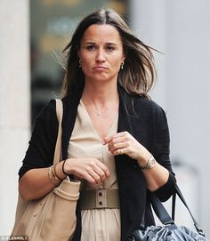 PICTURE EXCLUSIVE: Pouting Pippa Middleton cuts a businesslike figure in beige on a stroll down a London street Pippa Middleton was spotted walking down the street in London's Fulham Wore a businesslike beige dress topped with a neatly tailored black jacket Miss Middleton is currently studying for a qualification in nutrition  - 28 May 2015