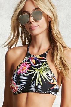 f062e40636077 A knit bikini top featuring an allover tropical birds of paradise floral  print