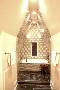 Exceptional use of a small bath space. The floor to ceiling mosaic tile for the tub and shower looks sharp!