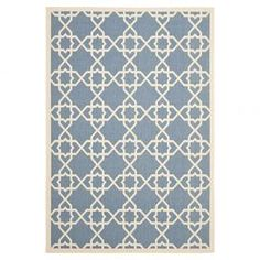 "Add a lovely touch to your patio or living room with this eye-catching indoor/outdoor rug, showcasing a trellis motif in blue and beige.  Product: RugConstruction Material: PolypropyleneColor: Blue and beigeFeatures:  Power-loomedTrellis motifMade in Turkey Suitable for indoor or outdoor use  Pile Height: 0.25""  Note: Please be aware that actual colors may vary from those shown on your screen. Accent rugs may also not show the entire pattern that the corresponding area rugs ..."
