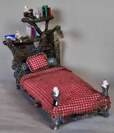 Tiny Fairy House Bed.. Omg.. I love it!! So cute, and the tiny books look awesome