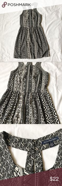 American Eagle Printed Dress Black and ivory Printed sun dress from American Eagle Zipper detail and fun strap pattern on back of dress Fitted through the bodice Pre-owned, great condition! Perfect for graduation or the weekend! American Eagle Outfitters Dresses Mini