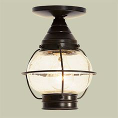 Onion Porch Lantern: Steal  This brass lantern is machine crafted, but an oiled bronze finish and bubbles in the seeded glass globe give it vintage style. Five feet of chain come in the box, giving you the option to let the lantern hang or flush-mount it on the ceiling.    Cape Cod Porch Light, 9 inches high, in Sienna Bronze, about $145; House of Antique Hardware