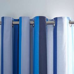 Made from durable polycotton and featuring stripes in various shades of blue, these eyelet curtains come complete with a blackout lining to block out unwanted l. Striped Bedding, Linen Bedding, Bed Linen, Kids Bedroom, Bedroom Decor, Bedroom Ideas, Boy Bedrooms, Childrens Blinds, Toy Story Nursery
