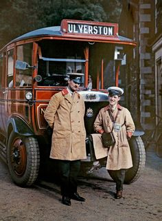 Two bus drivers stand in front of a tour bus in Ulverston, Cumbria.Color Photographs of England in 1928 (Photos: Clifton R. Adams/National Geographic Creative/Corbis, via Mashable/ Retronaut)