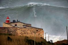 Surfer breaks own record on 'biggest wave'
