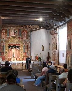 El Santuario de Chimayó... only 30 miles from Santa Fe, NEW MEXICO is El Santuario de Chimayo... where 300,000 visitors each year come to scoop sand from a hole in the floor of the 'Room of Miracles'. Its walls are lined with letters and photographs from hundreds of thankful pilgrims who say they were healed here...