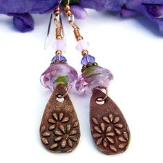 The whimsical MARGHERITA handmade earrings are perfect when you need an energizing boost of flower power. The earrings feature artisan made copper teardrops with a raised daisy flower design and pink lampwork glass beads. The teardrops were molded, shaped, carved and fired by the artist from beginning to end. @shadowdog  #bmecountdown