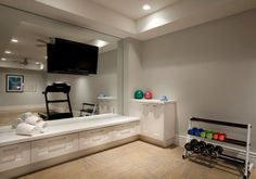 A home gym can be a great convenience. However, coming up with the perfect home gym design to suit personal preferences can be a challenge. The best home gym design increases the chance of… Home Gym Basement, Gym Room At Home, Home Gym Decor, Basement Workout Room, Workout Room Home, Workout Rooms, Exercise Rooms, Workout Room Decor, Home Remodeling Contractors