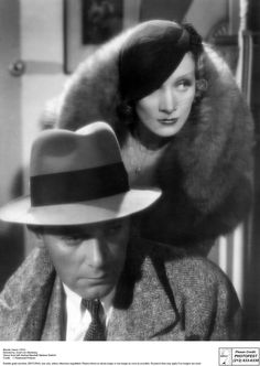 "Herbert Marshall and Marlene Dietrich in the 1932 film ""Blonde Venus."""