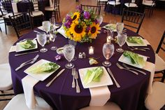 Purple tablecloth with white plates and white napkins « The Cuvier Club