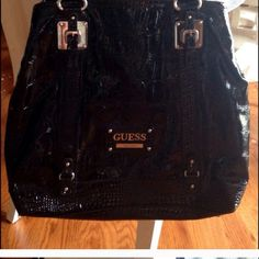 Guess Authentic Handbag(XL Black) Beautiful Authentic Black XL Guess Handbag. Purchased from a fellow Posher, but it's not really my taste & it needs a new home. In excellent condition & no holes, stains or flaws that I can seeOr Best Offer Guess Bags