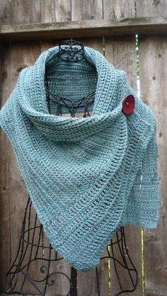 Turquoise buttoned wrap.....clearly someone needs to teach me how to do this! 55.5 inches wide and 15 inches long