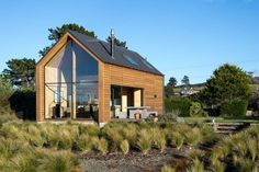 """This New Zealand """"bach"""" (a simple vacation home) has a 592 sq ft main level plus two attic loft bedrooms.   www.facebook.com/SmallHouseBliss"""