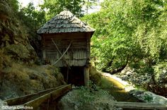 The 22 watermills from Eftimie Murgu are a rare attraction in Romania and the largest watermills park from South-East Europe. South East Europe, Medieval Town, Bucharest, Cemetery, Adventure Travel, Gazebo, Museum, Outdoor Structures, Culture