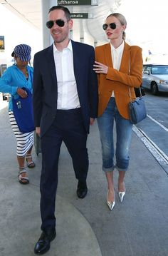 Kate Bosworth wears a camel blazer with a white blouse, cropped jeans and metallic flats.