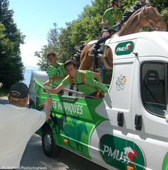 Tour de France Caravan handing out PMU Hands