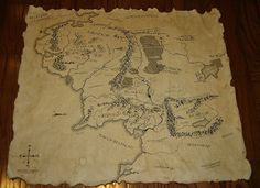 Middleearth map printed on high quality fine art paper, antiqued by using coffee beans, coffee, tea bags, ashes, and a candle to control burning the edges.