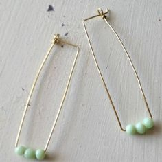 Make Anthropologie Inspired Wire Earrings in this easy knockoff tutorial. These earrings are stunning, yet simple. #knockoff #how-to-make-earrings