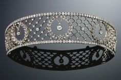 Diamond Tiara, Late 19th Century       In the garland style, designed as a bandeau of open work trellis design centering on three graduated wreaths, set with circular-cut diamonds. (Sold for $37,704)