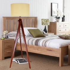 Rustic 1-Light Natural Wooden Tripod Floor Lamp with Fabric Drum Shade, providing a haven of tranquility for your bedroom.
