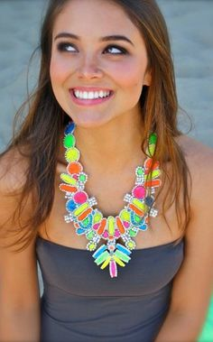 This necklace would bring the color out so big and bold!!