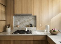 NYC compact kitchen with custom stepped oak cabinets by Workstead , Matthew Williams photo