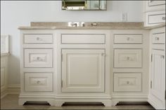 Inset Vanity with Bead and Solid Pin Hinges by A. Fillinger Inc.