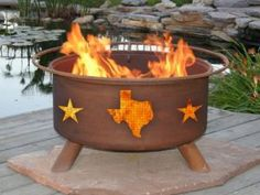 .... Love the stone underneath so you can have a fire pit on a wooden deck...