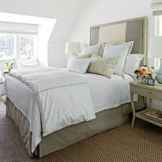 Guest Suite: The Bedroom | Relying on a mature, gender-neutral palette of deep taupes, soft grays, and crisp whites, the space is grounded with Hickory Chair's Candler Bed and shapely West Paces Side Tables in matching birch finishes.