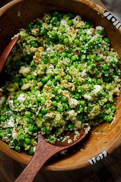 A spring couscous salad with lots of couscous, walnuts, feta cheese, and peas. Salad is tossed in a basil vinaigrette and perfect for picnics and barbecues!